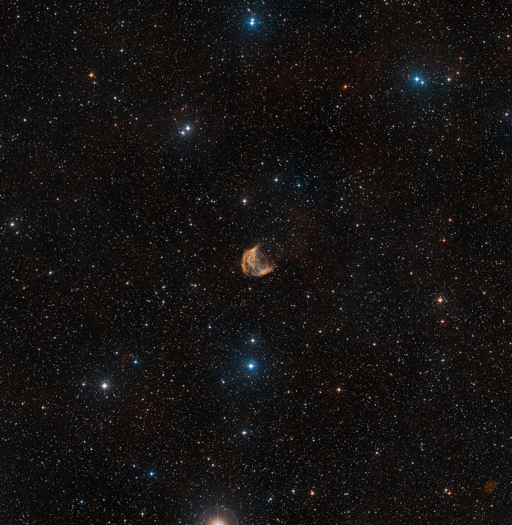 This wide-field view shows the sky around the large but faint planetary nebula known as the Medusa Nebula. The full extent of the object can be seen, as well as many faint stars and, far beyond them, numerous distant galaxies.This picture was created from images forming part of the Digitized Sky Survey 2.