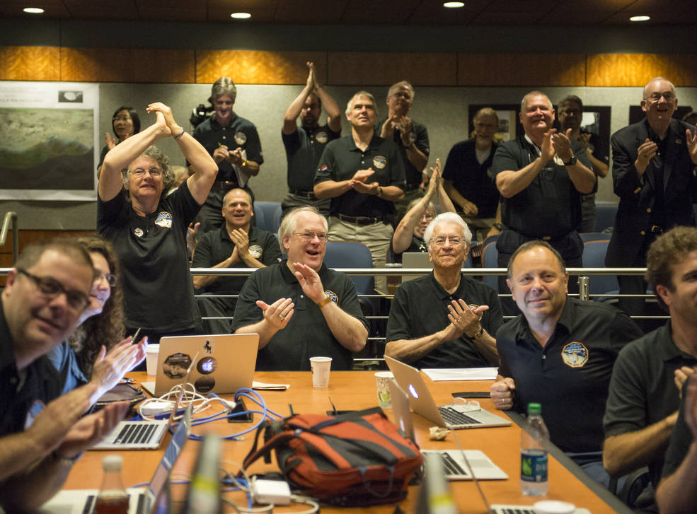 Members of the New Horizons science team react to seeing the spacecraft's last and sharpest image of Pluto before closest approach later in the day, Tuesday, July 14, 2015 at the Johns Hopkins University Applied Physics Laboratory (APL) in Laurel, Maryland. Photo Credit: (NASA/Bill Ingalls)