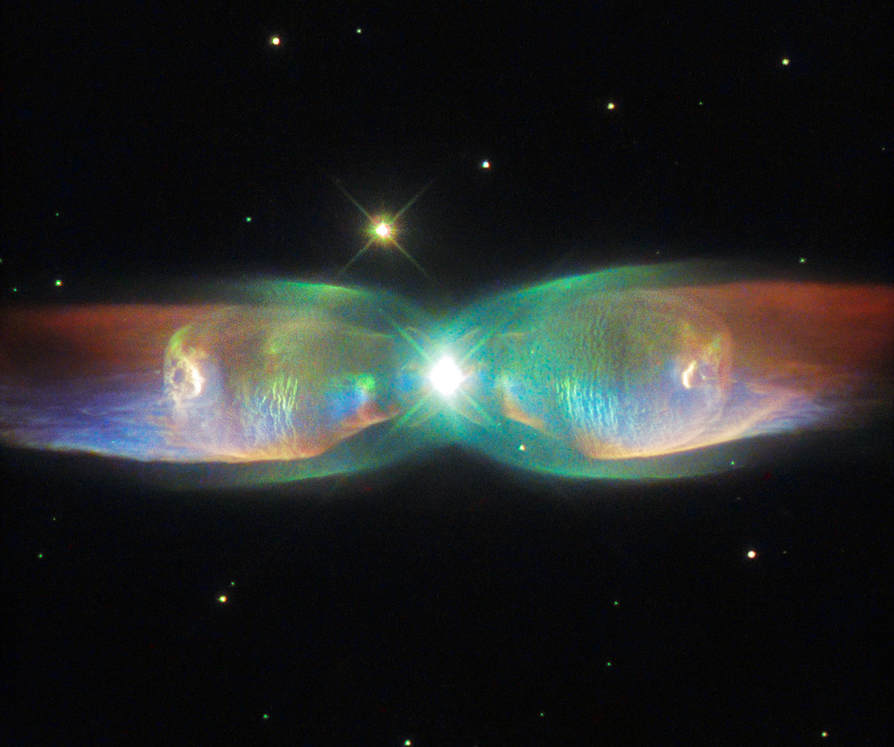 The Twin Jet Nebula, or PN M2-9, is a striking example of a bipolar planetary nebula. Bipolar planetary nebulae are formed when the central object is not a single star, but a binary system, Studies have shown that the nebula's size increases with time, and measurements of this rate of increase suggest that the stellar outburst that formed the lobes occurred just 1200 years ago.
