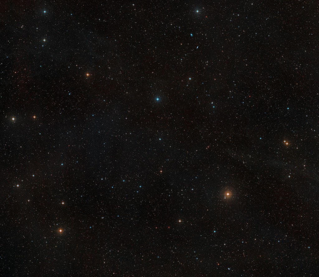 This image shows the sky around the nearby young star AU Microscopii. It was created from images forming part of the Digitized Sky Survey 2. AU Mic appears just below the centre of the image as an orangish star of moderate brightness. Because the photographs through different coloured filters that were used to make this picture were taken many years apart, AU Mic appears double, as the star's own proper motion has moved it a small distance across the sky in the intervening time.