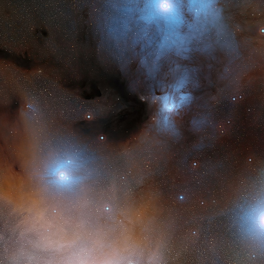 This wide-field view shows a spectacular region of dark and bright clouds, forming part of a region of star formation in the constellation of Ophiuchus (The Serpent Bearer). This picture was created from images in the Digitized Sky Survey 2.